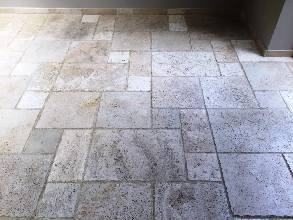 Pitted travertine floor tiles before cleaning in Andover
