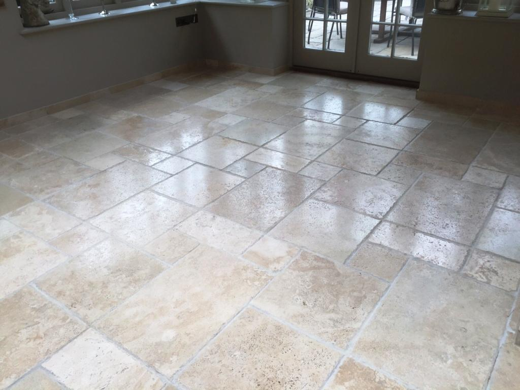 Pitted travertine floor tiles after burnishing in Andover