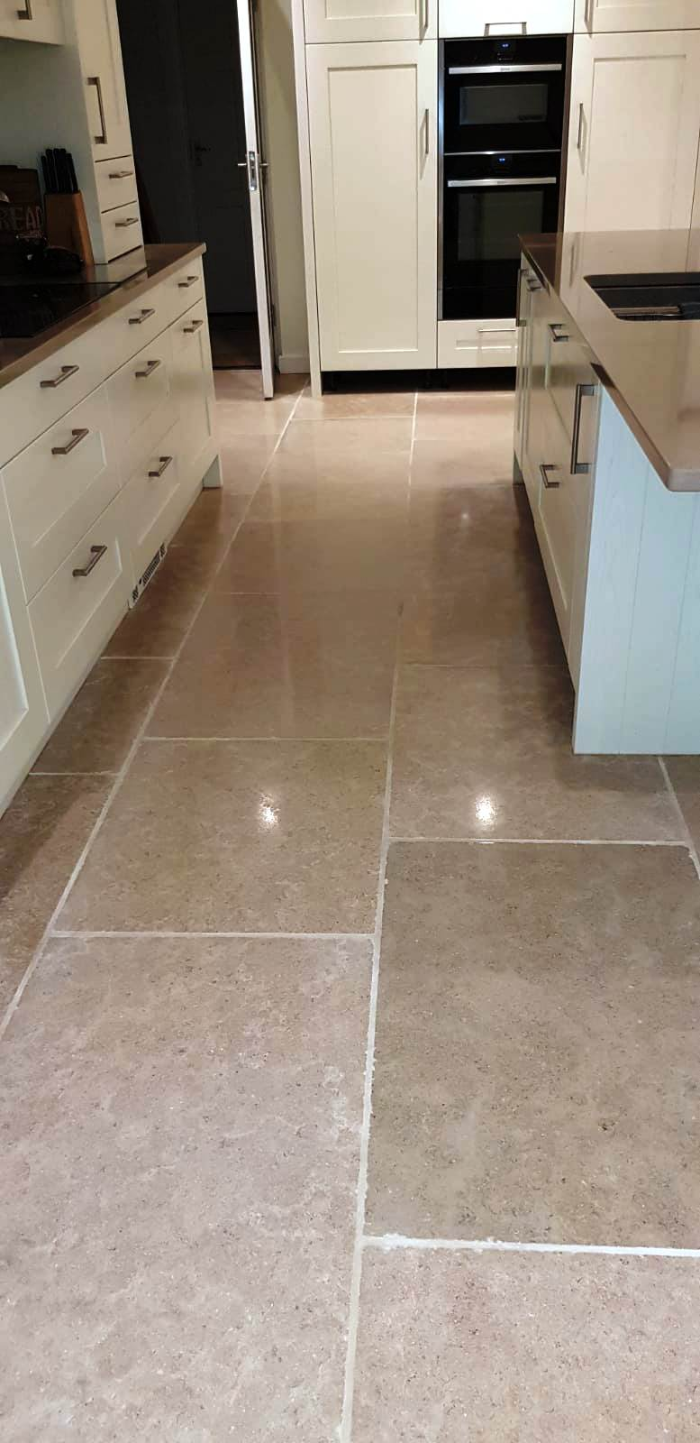 Uneven limestone tiled floor Wickham after levelling